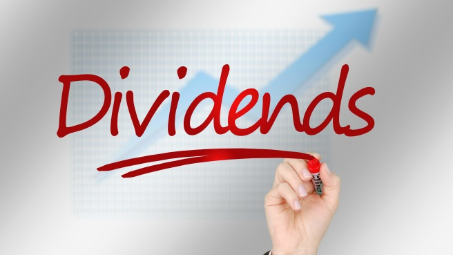 hand-with-marker-writing-dividends